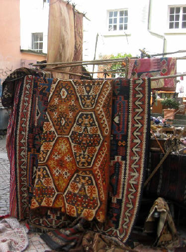 ROSENHOF SQUARE MARKET ZURICH SWITZERLAND. Hand-made clothing, leatherware, carpets, jewelry is sold by dealers from many countries. Food is also available. Open on Saturdays 10 am until  5 pm from March through October and Thursdays 10 am to 8 pm on Thursdays.